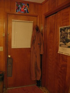 my lovely coveralls, hanging by the door and ready to be donned